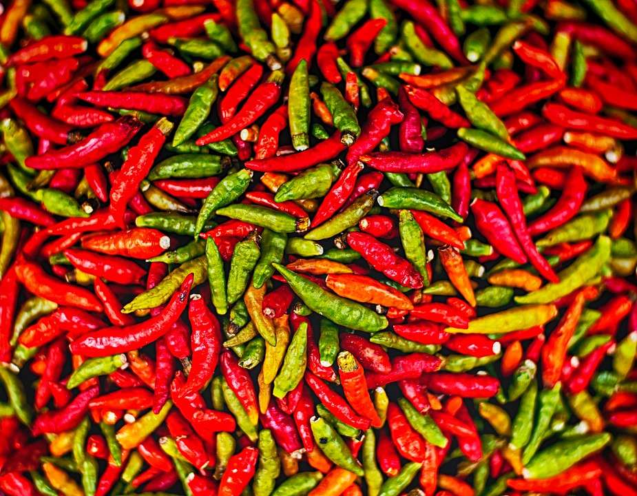 A selection of red, yellow and green chillies