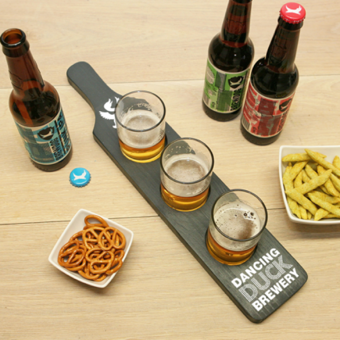 Our wooden beer paddles styling a small selection of ales